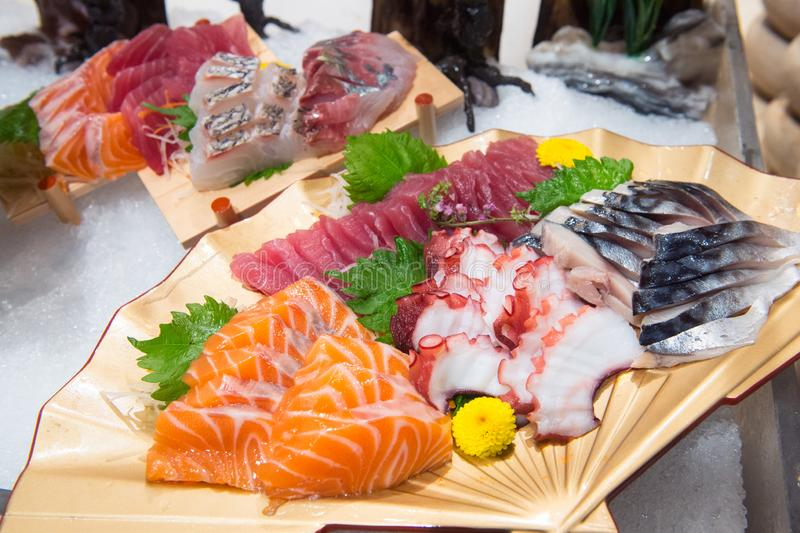 Sashimi on a plate in a Japanese restaurant royalty free stock photo