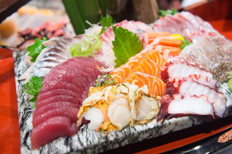 Sashimi on a plate in a Japanese restaurant royalty free stock photography