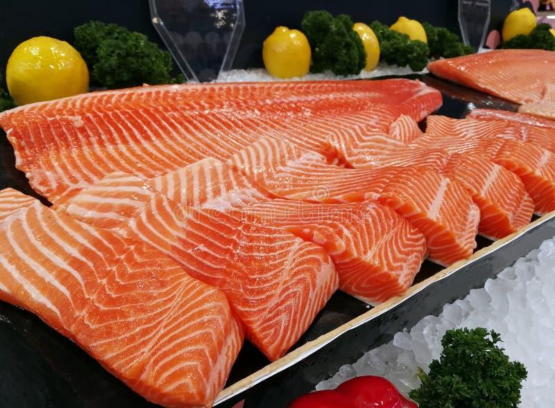 Sashimi salmon raw with fish fillets fresh. Sashimi salmon raw with fish fillets a fresh royalty free stock photos