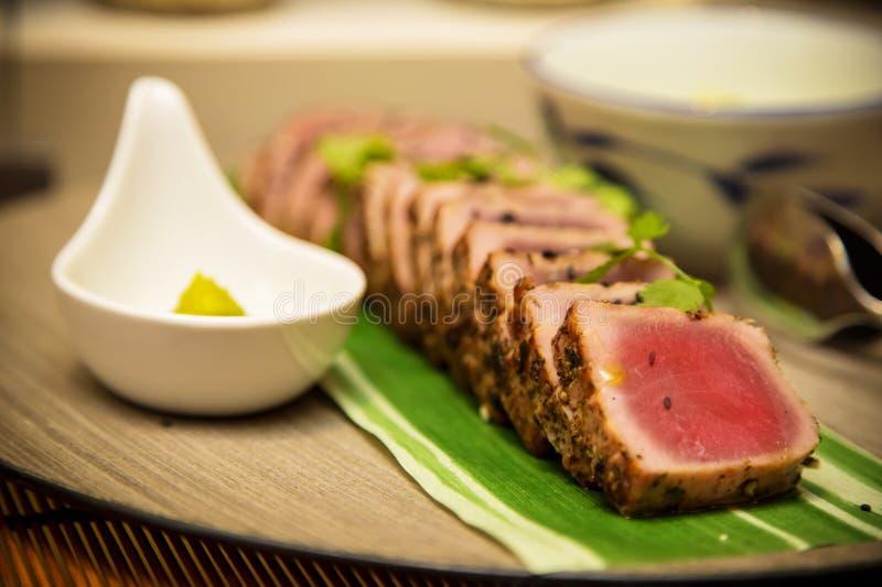 Sashimi. Seared tuna steak called Sashimi traditional Japanese dish with wasabi sauceon side stock image