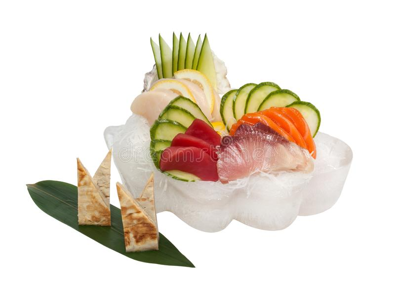 Sashimi set with raw fresh scallops, sea bass, tuna, salmon, cucumber, rice noodles stock photography