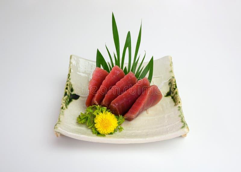 Sashimi sliced Maguro or Tuna on plate. Sashimi sliced Maguro or Tuna on ceramic plate royalty free stock photography
