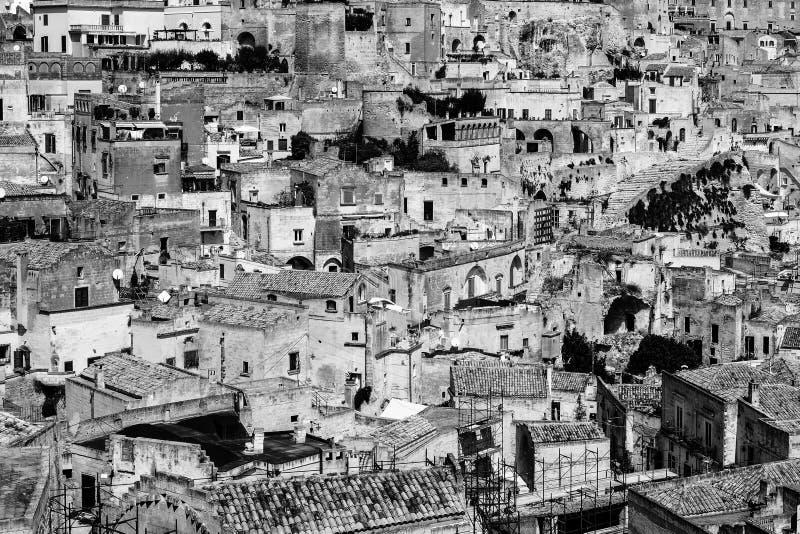 Sassi di Matera gammalt grottahus i italiensk forntida grottastad royaltyfria bilder