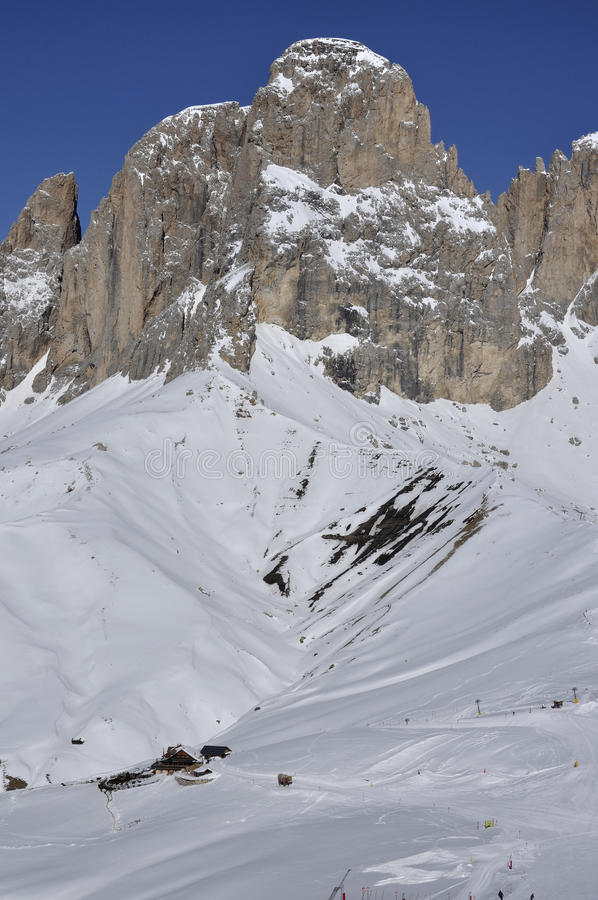 Sasso lungo detail, dolomites. View of famous mountain in dolomite with steep cliffs and snowy slopes, shot in bright winter light stock photo