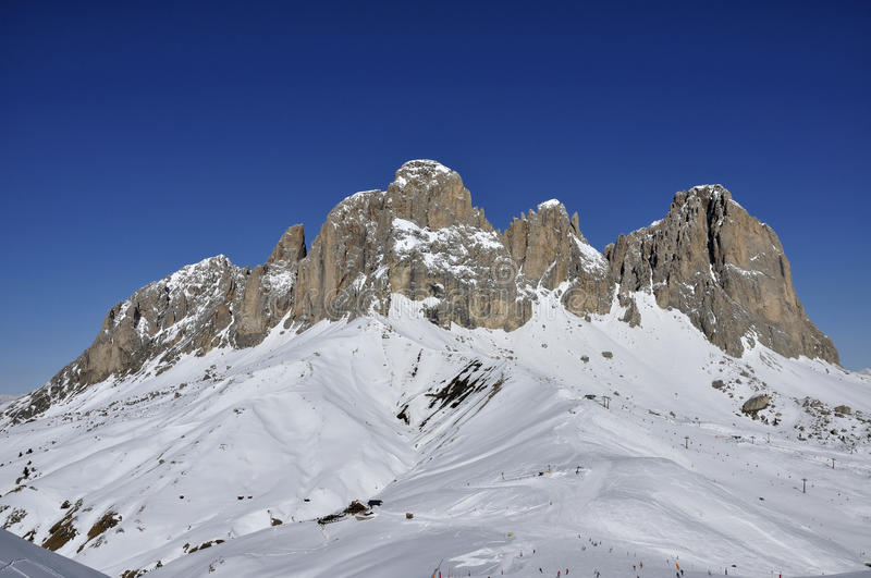 Sasso lungo group, dolomites. View of famous mountain in dolomite with steep cliffs and snowy slopes, shot in bright winter light stock photography