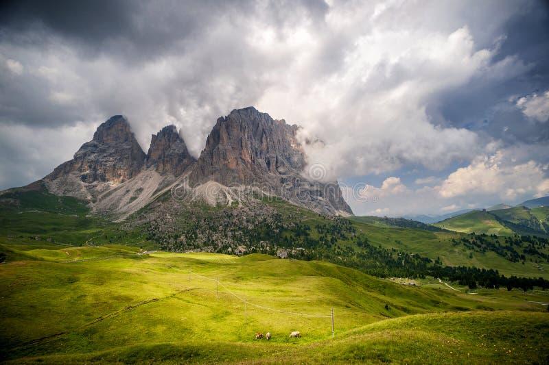 Sassolungo and Sassopiatto mountains with clou sky from Sella pass, Dolomites Alps , Trentino Alto Adige South Tyrol, Italy. Sassolungo and Sassopiatto mountains stock images