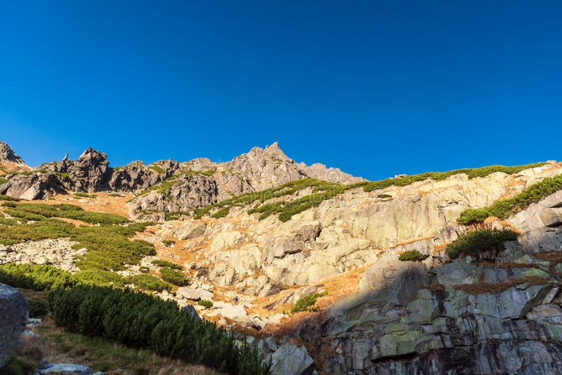 Satan mountain peak from hiking trail near vodopad Skok waterfall on Mlynicka dolina valley in Vysoke Tatry mountains in Slovakia. During beautiful autumn stock photos