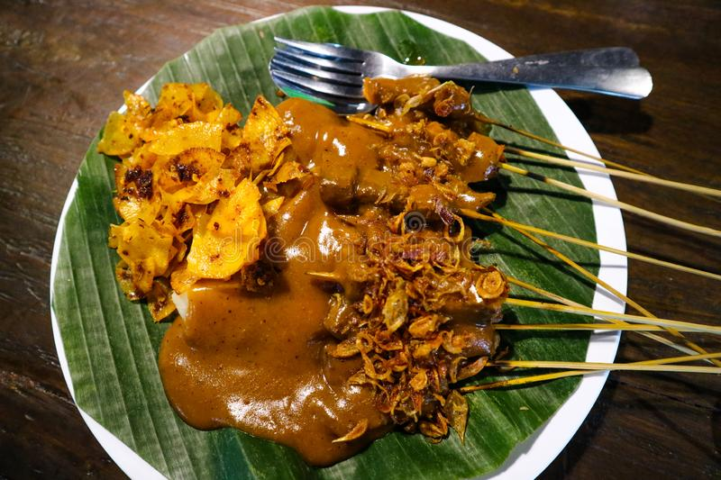 Satay Padang with spicy spices food characteristic of the Indonesian Padang area. royalty free stock photography