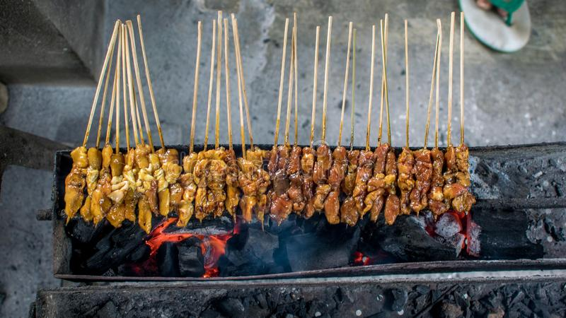 Satay or sate is an Indonesian and Malaysian dish consisting of small pieces of meat stock image