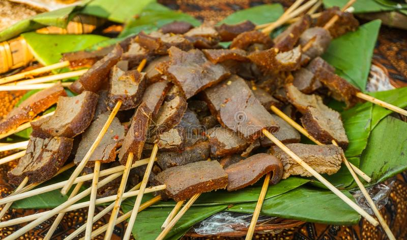 Satay sate skin cow with brown color and banana leaf to serve traditional food stock photography