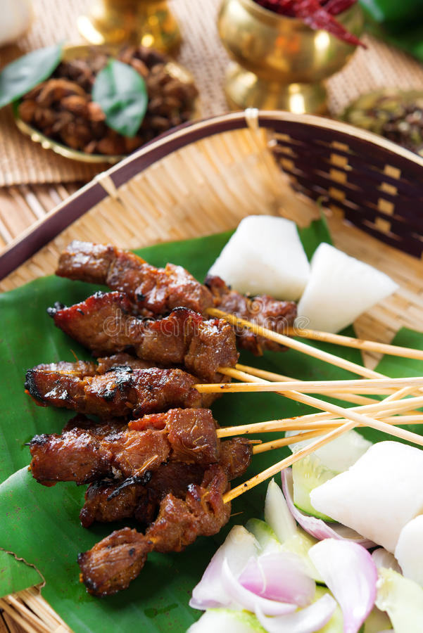 Satay Singapore food. Beef satay, roasted meat skewer Malay food. Traditional Singapore food. Hot and spicy Singaporean dish, Asian cuisine stock image