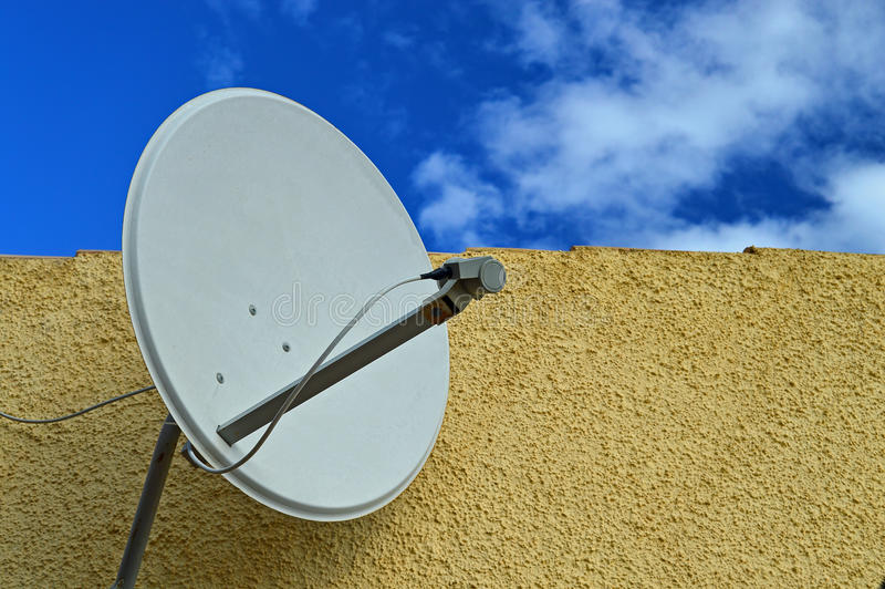 Satellite Dish. A domestic television satelite receiver dish stock photo