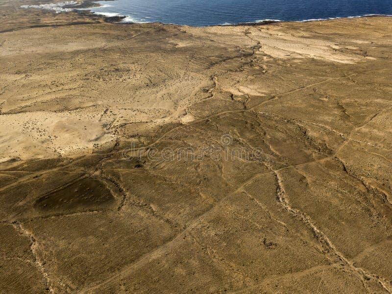 Satellietbeeld van een woestijnlandschap op het Eiland Lanzarote, Canarische Eilanden, Spanje Woestijnachtergrond, textuur Overze stock foto's