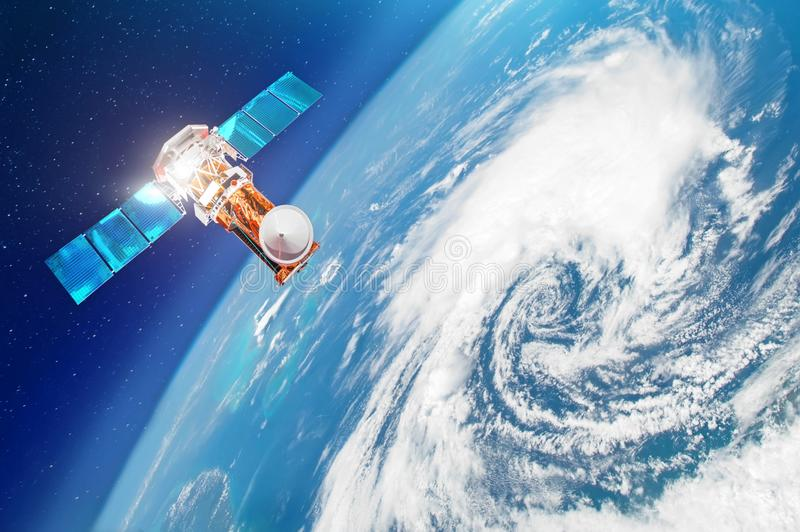 Satellite above the Earth makes measurements of the weather parameters. Research, probing, monitoring of tracking in a tropical st stock photos