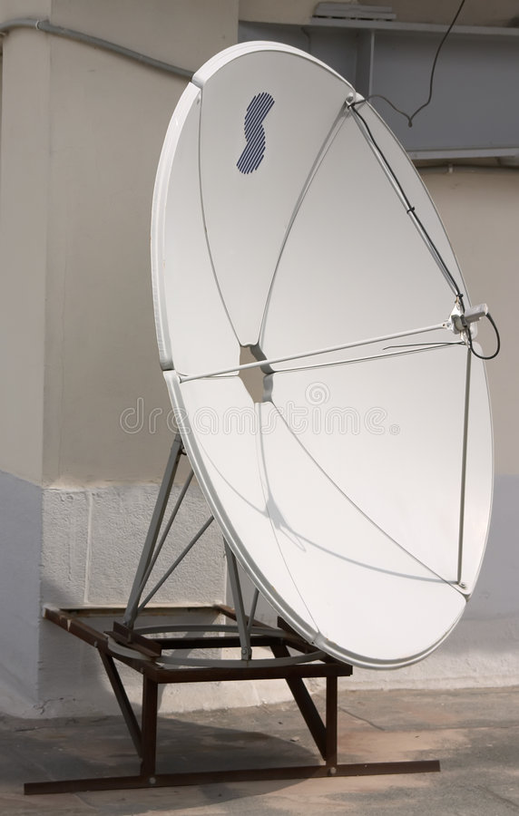 Satellite aerial. Small white satellite antenna on the roof royalty free stock images