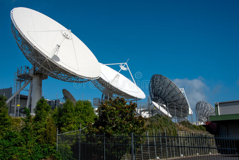 Satellite communication dish. Parabolic antenna designed to receive electromagnetic signals from satellites, which transmit data transmissions or broadcasts royalty free stock image