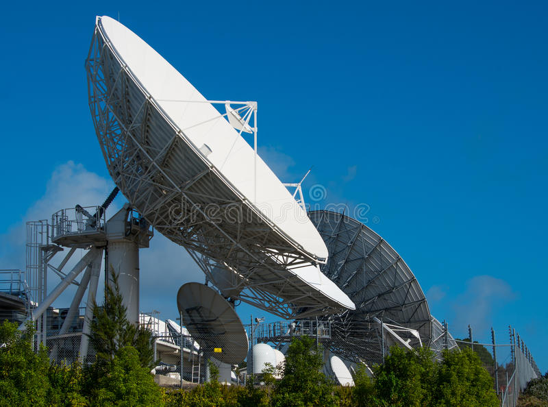 Satellite communication dish. Parabolic antenna designed to receive electromagnetic signals from satellites, which transmit data transmissions or broadcasts stock image