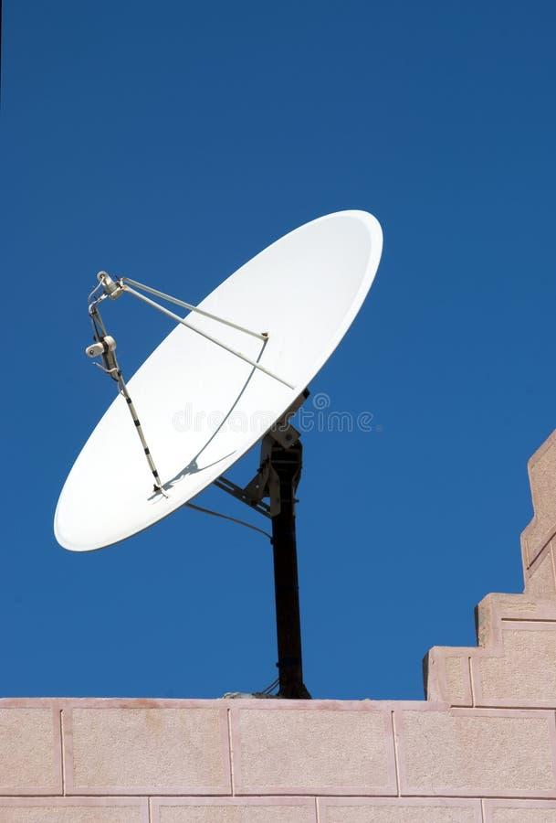 Satellite dish. TV satellite dish on a house roof stock image