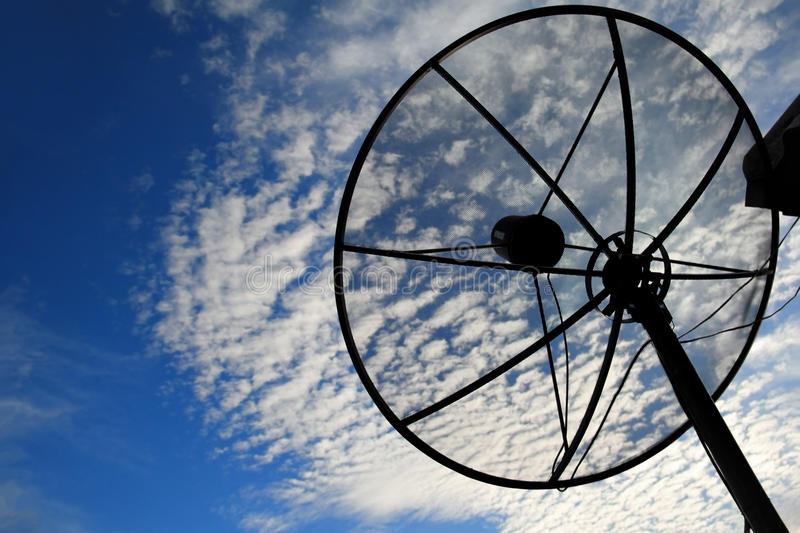 Satellite dish. The satellite dish on roof in evening sky stock photography