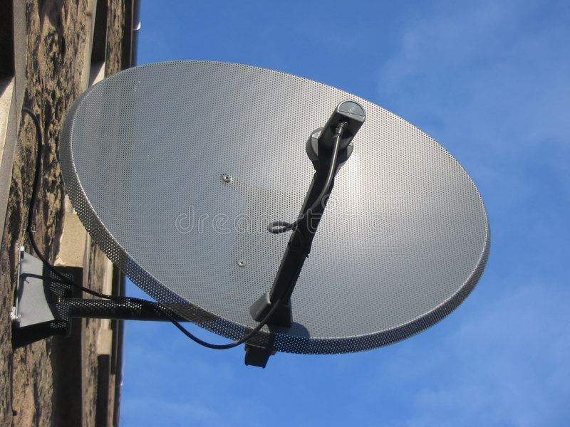 Satellite Dish. Mounted outside flats royalty free stock images