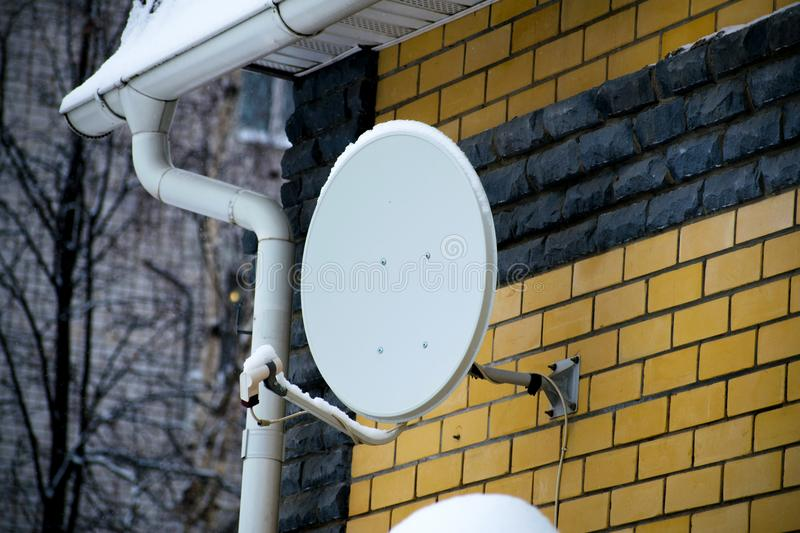 Satellite dish antenna on the house. royalty free stock photography