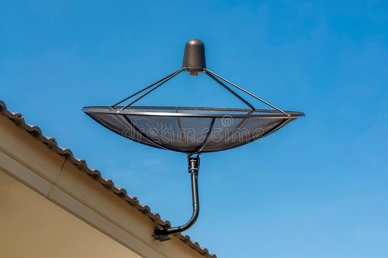 Satellite dish antenna on roof royalty free stock photography