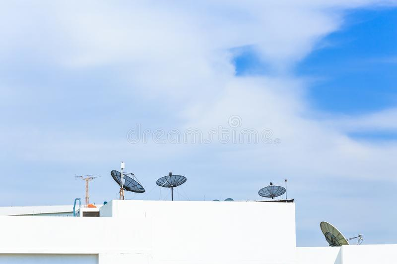 Satellite dish antenna on top of the building in urban area at n royalty free stock images