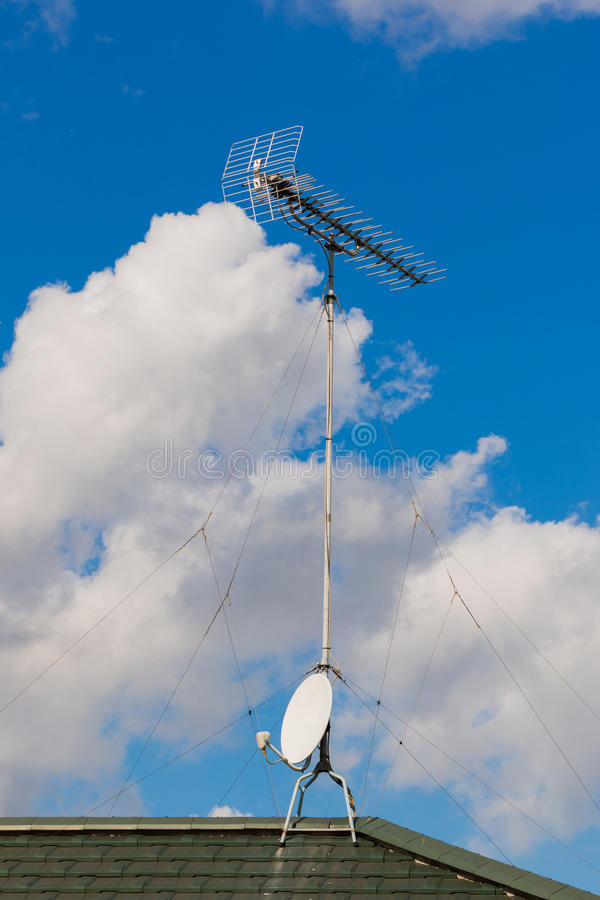 Satellite Dish and Antenna TV on Blue Sky. royalty free stock photography