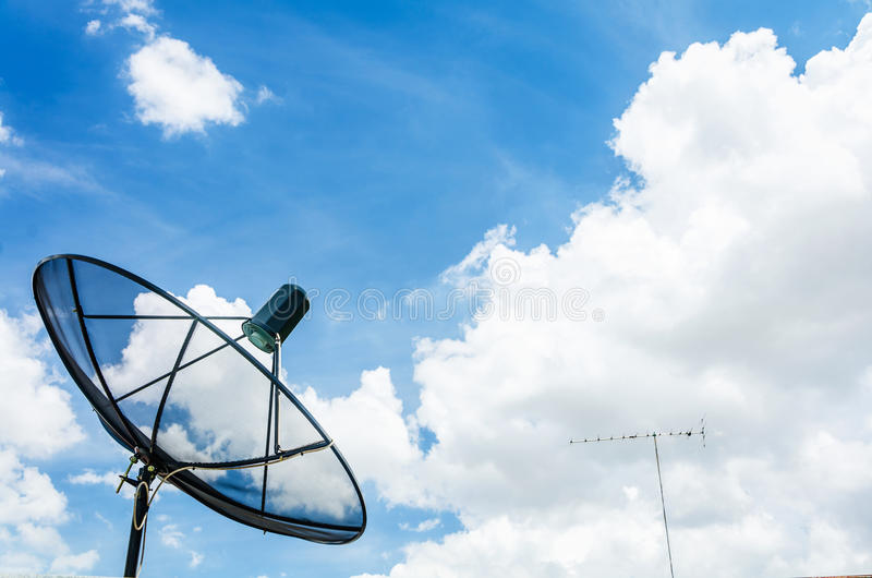 Satellite dish. On the blue sky royalty free stock photos