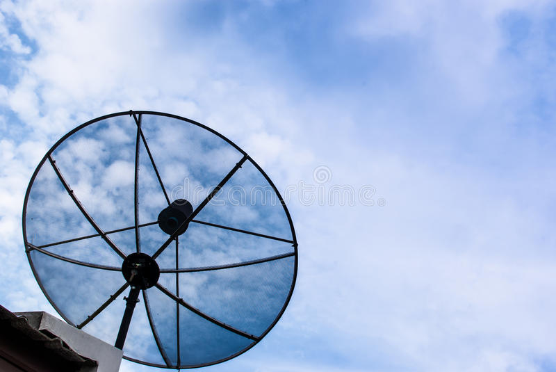 Satellite dish for communication. On the roof royalty free stock photos