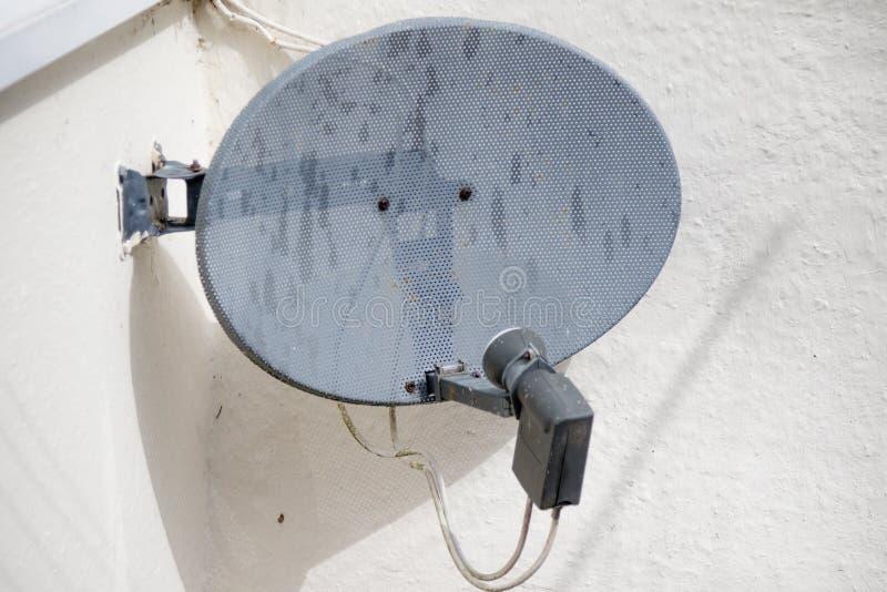 A satellite dish. A domestic TV satellite dish stock photography