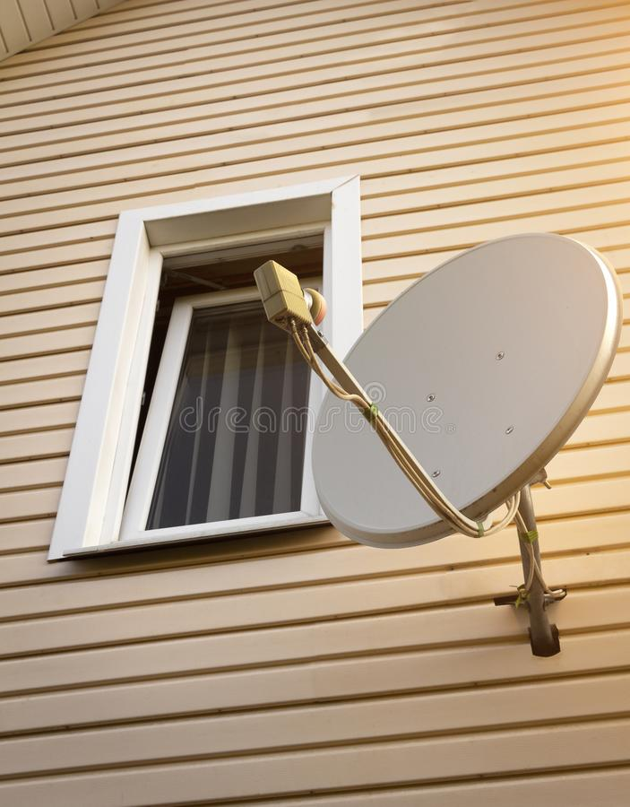 Satellite dish on the house. Satellite dish on the wall of a private house stock images