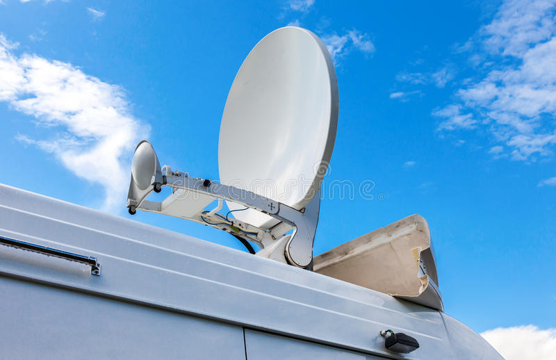Satellite dish mounted on the mobile television station. Satellite dish mounted on the roof of mobile television station royalty free stock photos