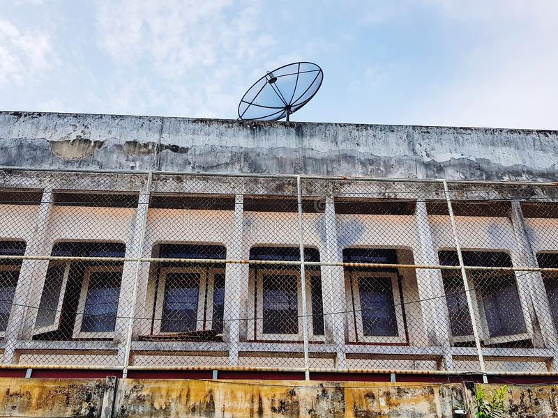 Satellite dish on old building stock photos