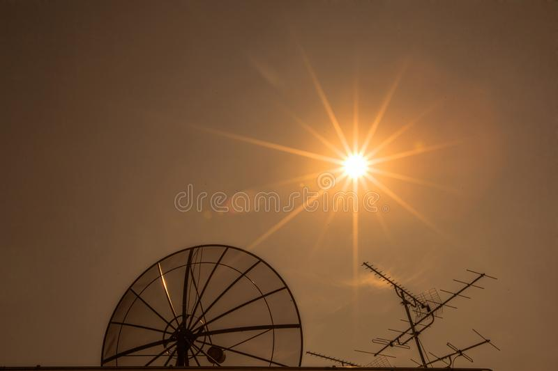Satellite dish with old television receiver stock photography