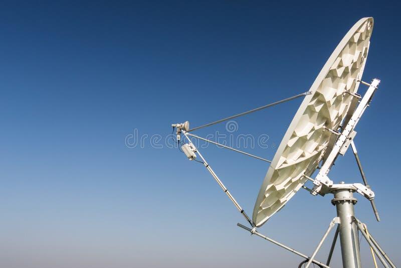 A satellite dish parabolic antenna. Communications satellites, which transmit data transmissions stock photos