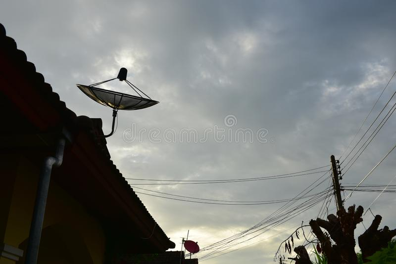 A satellite dish on the roof stock image