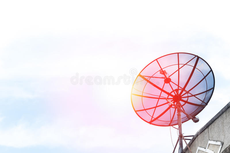 A Satellite dish on the roof royalty free stock image