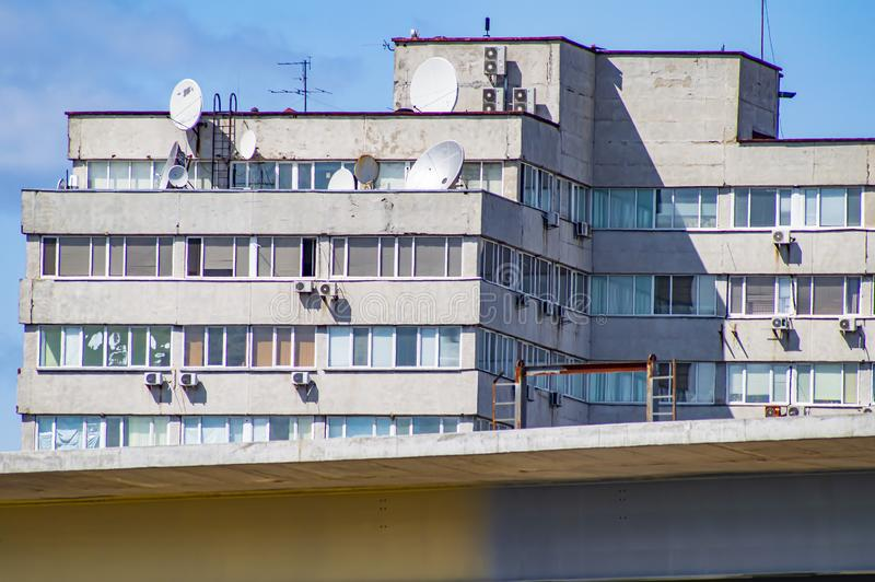 Satellite dish on the roof of the building. Technology stock photo