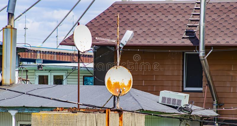 Satellite dish on the roof of the building. Technology stock images