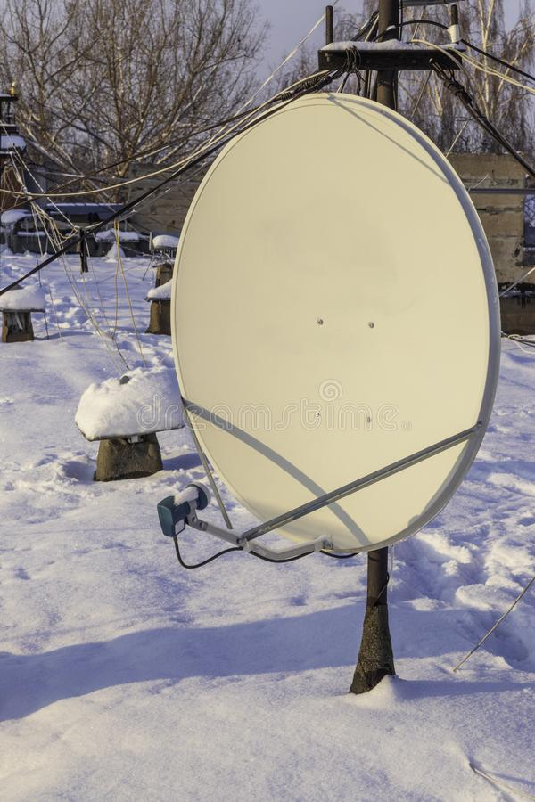Satellite dish on the roof of the old house stock photo
