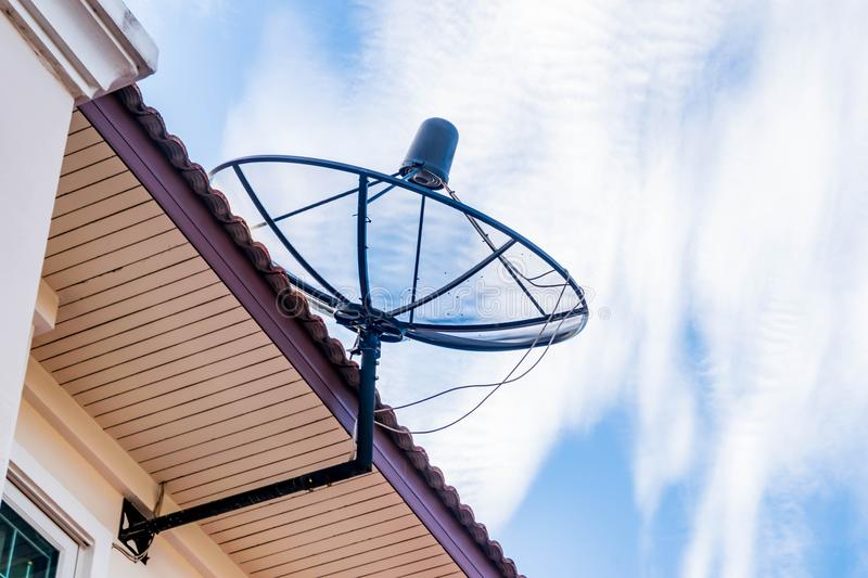 A satellite dish on the roof. stock image