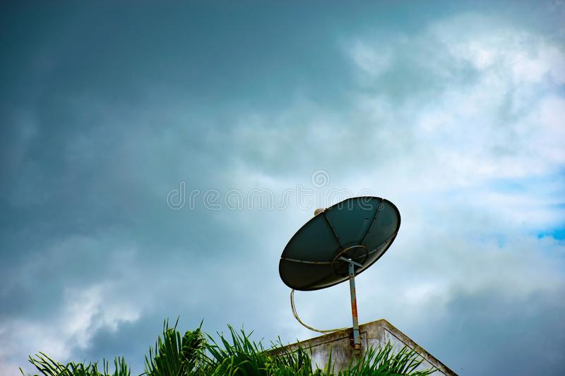 Satellite dish on roof top royalty free stock photos