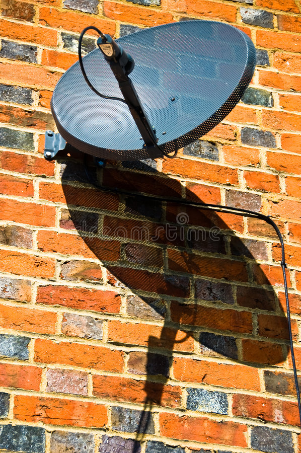 Satellite Dish and Shadow stock images