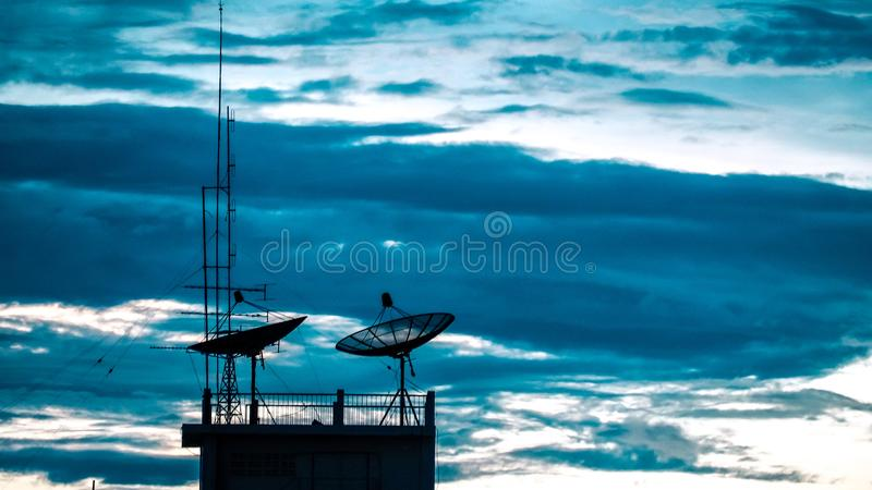 Satellite dish sky sunset communication technology network image background for design. Satellite dish sky sun stars communication technology network image royalty free stock photos