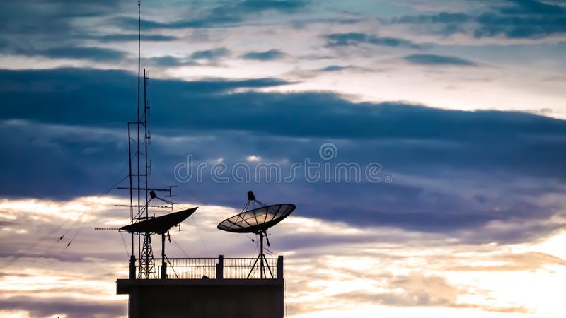 Satellite dish sky sunset communication technology network image background for design. Satellite dish sky sun stars communication technology network image royalty free stock images