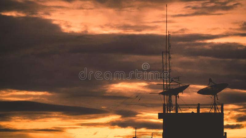Satellite dish sky sunset communication technology network image background for design. Satellite dish sky sun stars communication technology network image royalty free stock photo