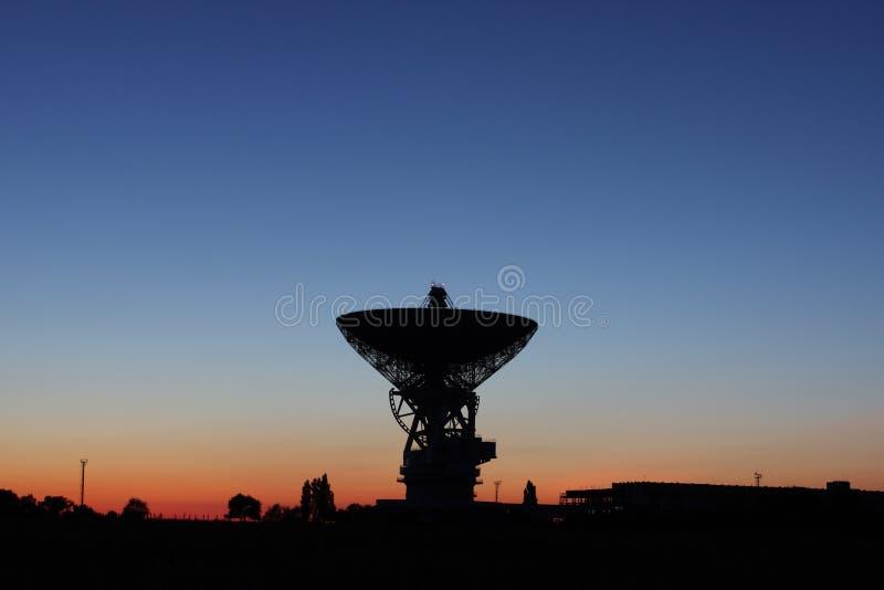 Satellite dish at sunset. royalty free stock photography