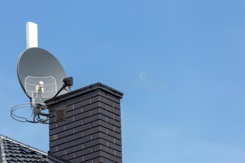 Satellite dish and tv, radio and wireless internet antenna. With empty copy cpace royalty free stock photo
