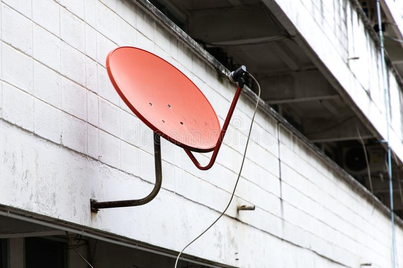 Satellite dish on wall royalty free stock image
